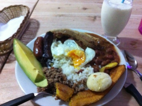 Bandeja paisas is a common dish from Medellin, Colombia. The food from that part of the country is what's known around the world as Colombian food.  We got rice, red beans, an egg, platanos, a small arepa, aguacate, hella chicarones, chorizo, and some other meat too.